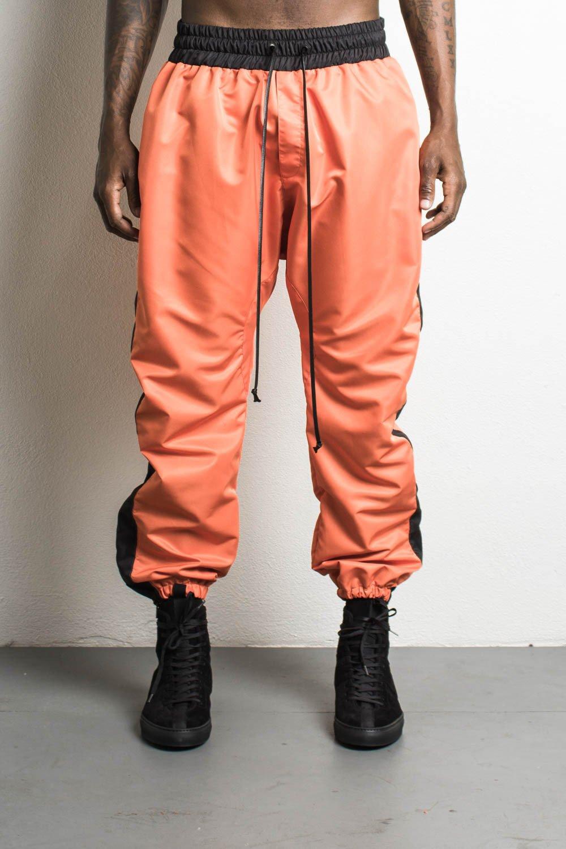 parachute pants orange/black oxipueu