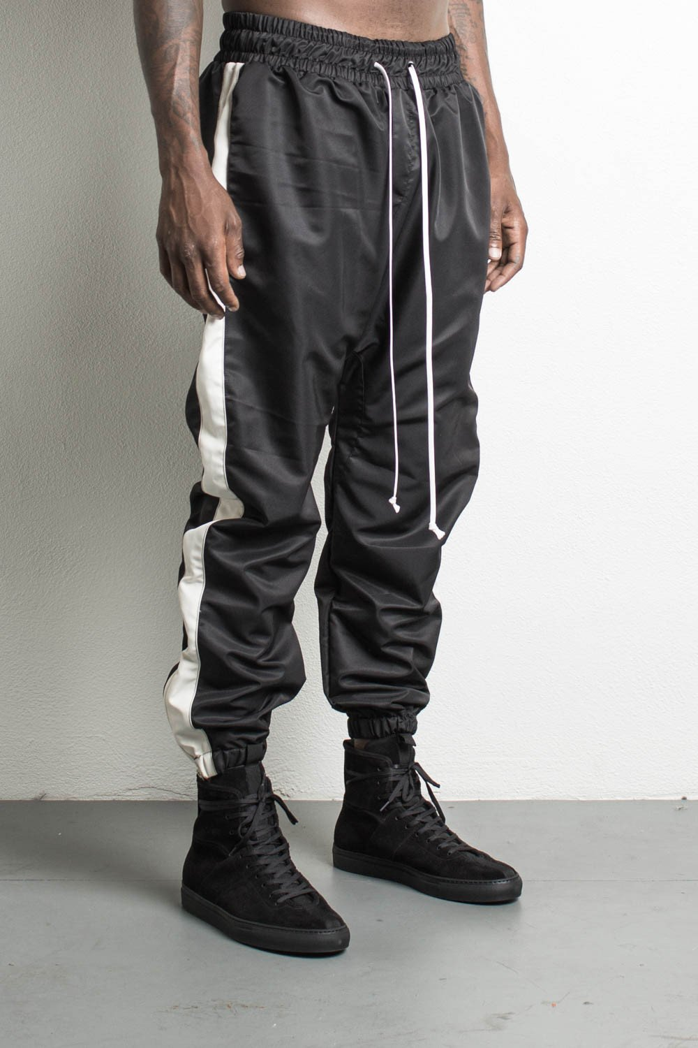 parachute track pants in black/natural by daniel patrick tzfiqlq