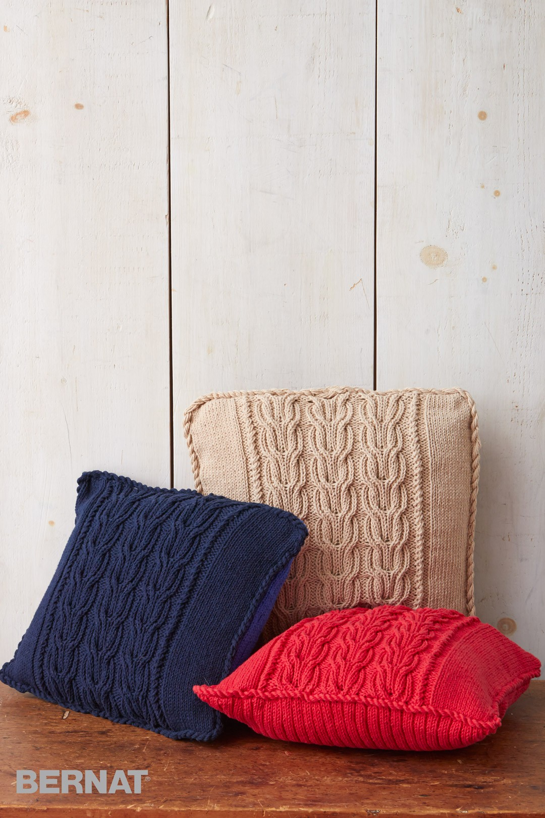 bernat patterns cable knit trio pillows. bernat pydrudo