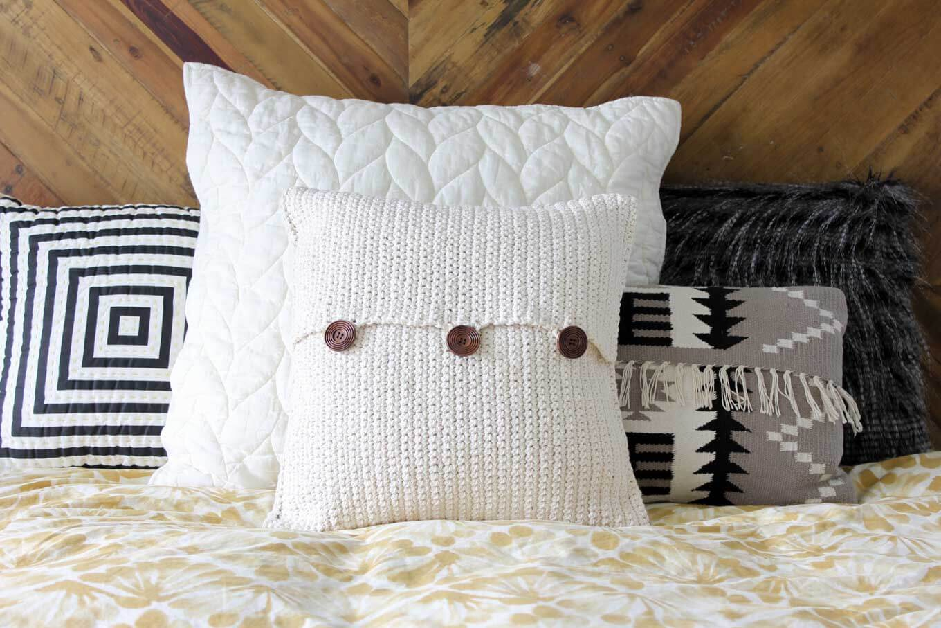 crochet pillow beginner crochet pattern. modern mudcloth pillow with button closures. make  and do megzhsr