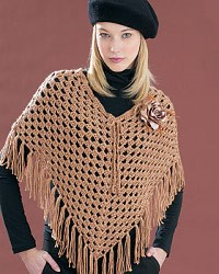 crochet poncho pattern 19): this crochet poncho has an open pattern which creates a fishnet look icylyjo