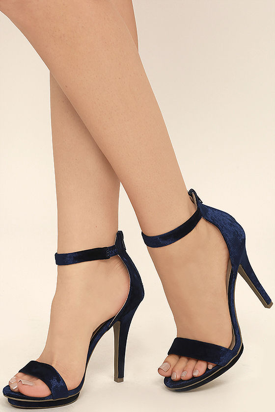 Acquire the world with navy   high heels