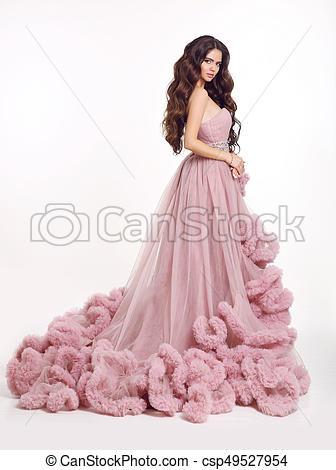 Beautiful woman in luxury lush pink dress. fashion lady brunette .