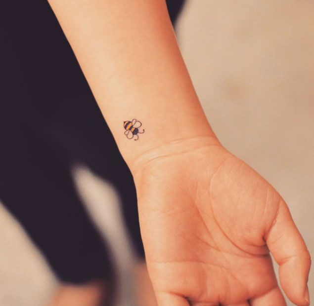 Tiny Bumble Bee Tattoo on Wrist by Grain | Animal tattoos for .