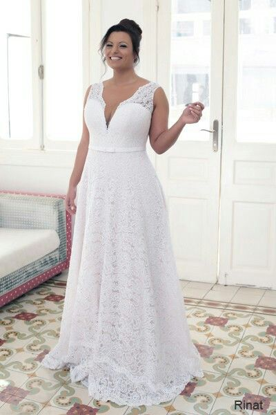 Elegant lace champagne plus size wedding gown creation. Comes with .