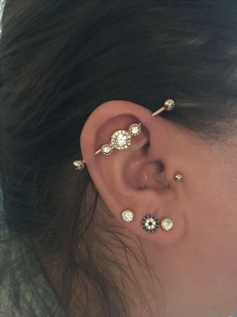 Tragus industrial lobe piercing rose gold Freaky's Tattoo .