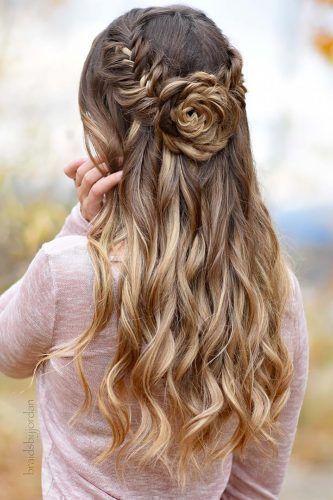 boho wedding hairstyles half up half down with flower-shaped bun .