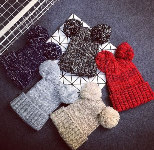 Keep warm and look cute with these pom-pom beanies. Twice the pom .