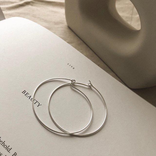 product photography, minimalist jewelry flatlay, minimalist .