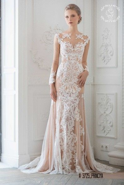 Wedding dress with illusion necklane and lace sleeves in champagne .