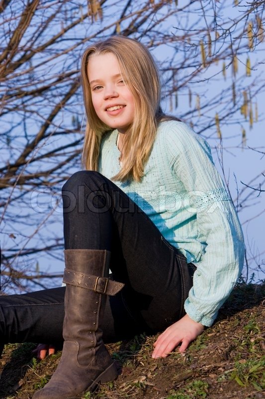 A smiling teenage girl with boots on | Stock image | Colourb