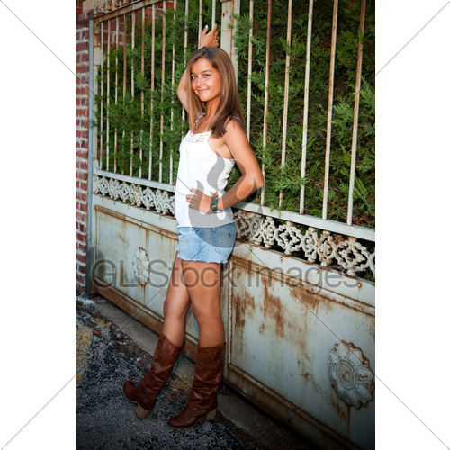 Teenage Girl Wearing Shorts Cowboy Boots Outside · GL Stock Imag