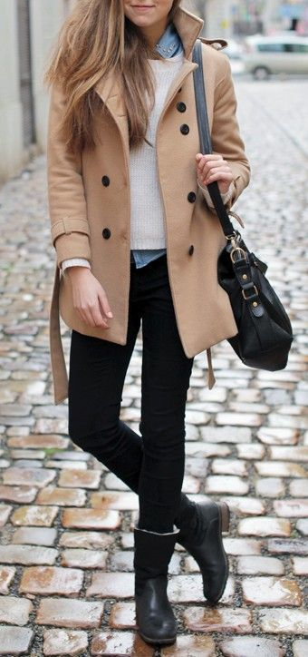 Black skinny pants, ankle boots, cream sweater, chambray button .